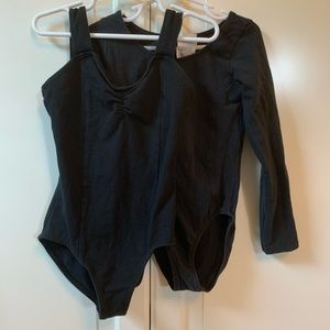 set of black leotards